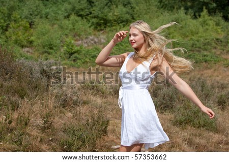 A beautiful blonde girl running with hair flowing
