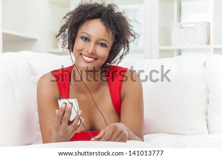 ... dress listening to music on mp3 player and headphones - stock photo