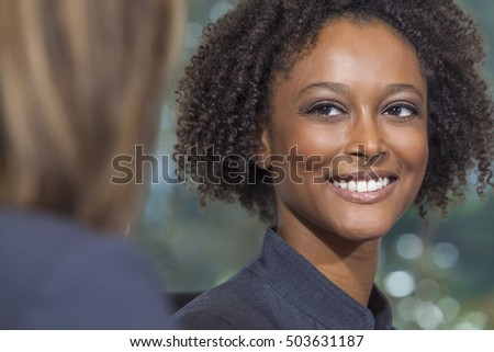 A beautiful mixed race African American young woman or businesswoman with perfect teeth