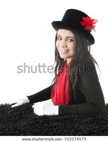 A beautiful teen girl posing pretty in a flower-adorned top had, red scarf and formal white gloves.  On a white background.