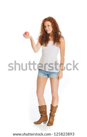 A beautiful woman holding a healthy apple.