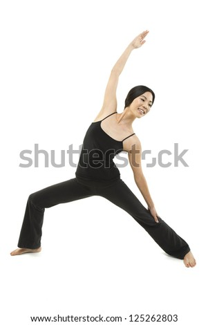A beautiful woman stretches and does a Yoga pose