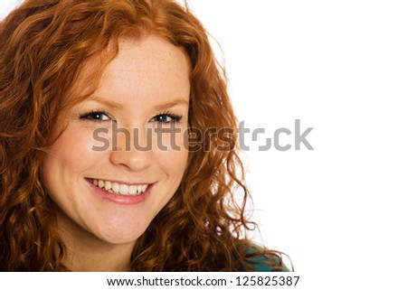 A beautiful woman with red hair and freckles