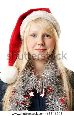 A beautiful young blonde in a Santa hat on a white background