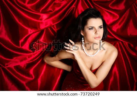 A beautiful young woman is in red clothes