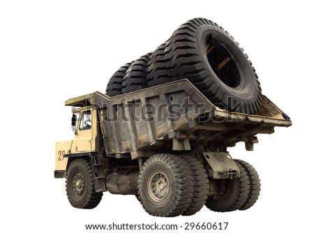 A big truck with very big wheels in the body, isolated.