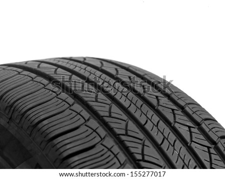 A black rubber tyre isolated against a white background