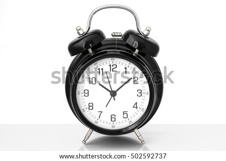 A black vintage alarm clock with white background