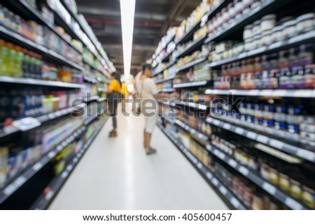 A blur background of people shopping in supermarket