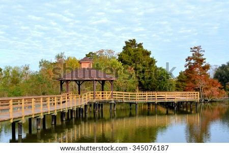 A boardwalk with a gazebo over a southern swamp in Lafreniere Park in Metairie, Louisiana.