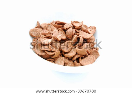 A bowl of crispy dry chocolate cereals for kids breakfast without milk. Image isolated on white studio background.