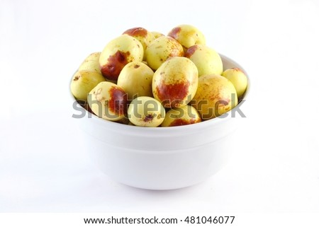 a bowl of fresh jujube on white background