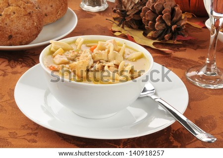 A bowl of turkey or chicken noodle soup