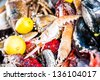 a bright colorful close-up on the catch of the day by a local fisher market - stock photo