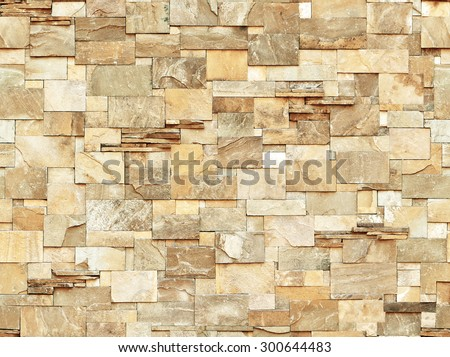 A brown brick/stone wall (repeated background)