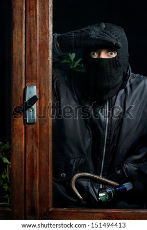 a burglar trying to enter through a window