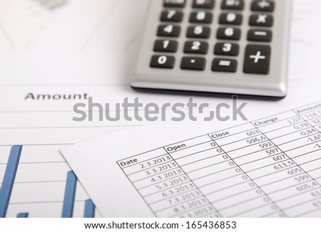 A business strategy concept with a calculator and color charts