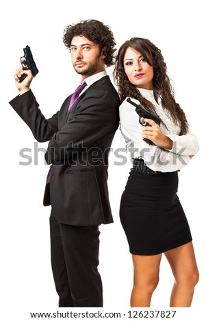 A businessman and a businesswoman (or maybe a couple of spies or gangster) holding guns over a white background