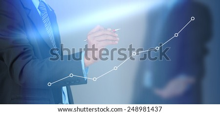 A businessman hand writing a business graph