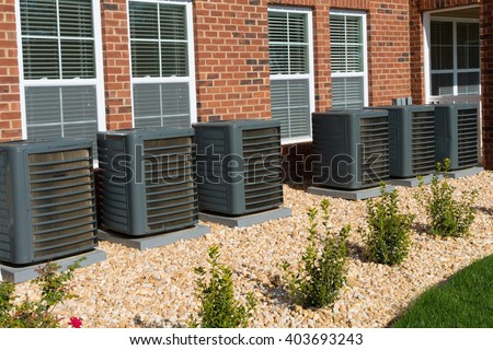 A/C units attached to apartment building