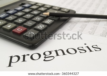 a calculator, a table with figures on a white background