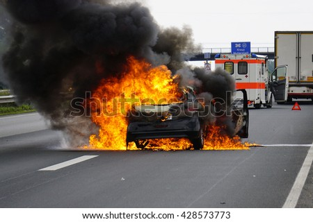 A car is ablaze on the highway