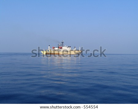 A cargo boat sailing in calm waters