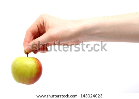 A Caucasian female hand holding an apple,