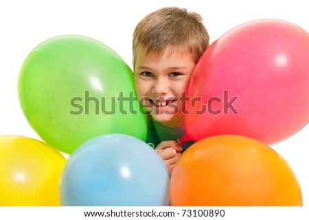 A cheerful boy is holding vivid balloons; isolated on the white background