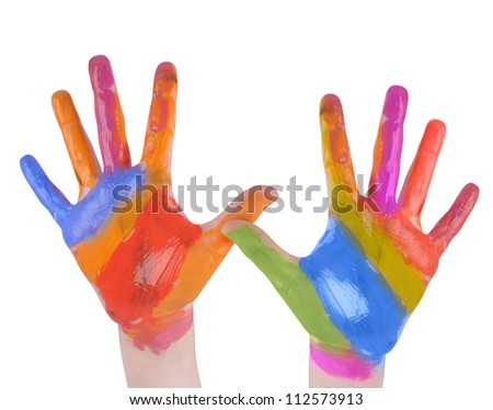 A child is holding up painted art hands on a white isolated background. There are vibrant rainbow colors. Use it for a creativity concept.