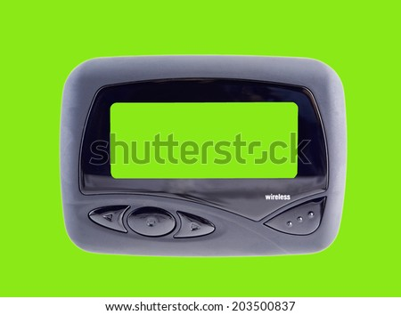 A chroma key green screen pager beeper with easy to remove background and copy space for your use. Isolated on green.