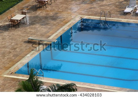 A clean open swimming pool with a plank