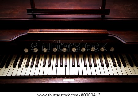A close up of a antique organ