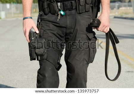 A close up of a police K9 dog handler's equipement