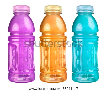 A close up on a set of isolated sports drink bottles.
