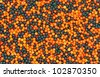 A close view of a group of black and orange tiny sprinkles. - stock photo