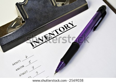A closeup of a clipboard with an inventory tally sheet and a pencil
