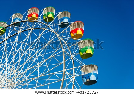 A colorful old ferris wheel awaits riders in Sydney, Australia.
