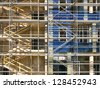 A concrete wall with scaffolding - stock photo