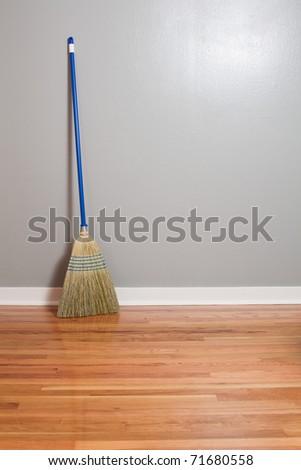 a corn broom on new hardwood floors