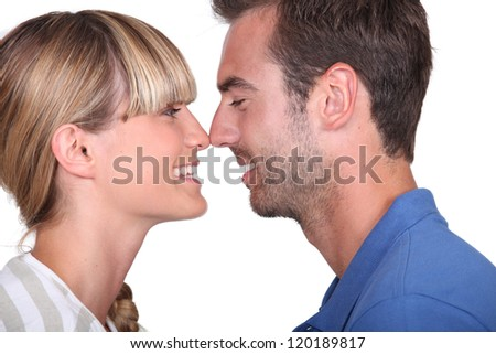 A couple about to kiss.