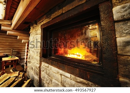a cozy fire in the fireplace closeup