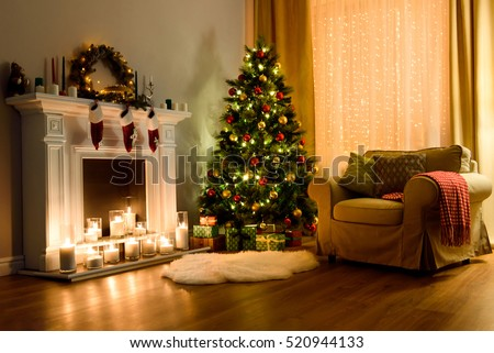A Cozy Living Room Lighted With Numerous Lights Decorated Ready To  Celebrate Christmas. Christmas Room