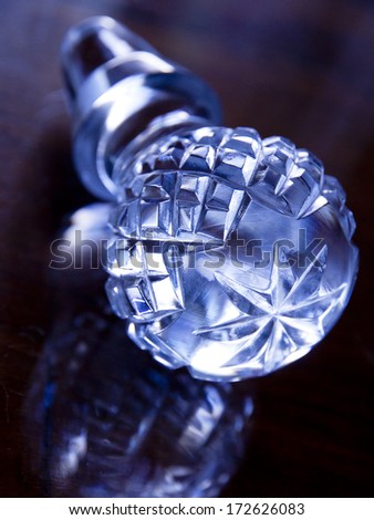 A crystal glass cap on dark background.