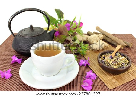 a cup of herbal tea and Chinese medicinal herbs