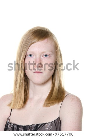A cute blond teen girl looking angry and intimidating on white background