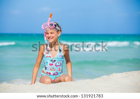 A cute girl wearing a mask for diving background of the sea