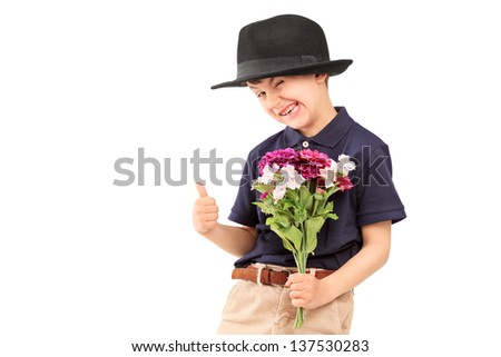 A cute little boy with a hat holding bunch of flowers, isolated on white background