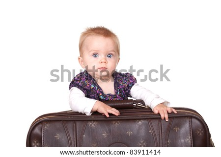 A cute travel image of a baby and her suitcase.  Image is isolated on white.