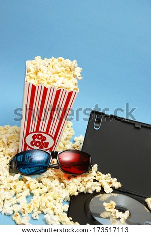 A 3D home movie experience with popcorn and glasses.